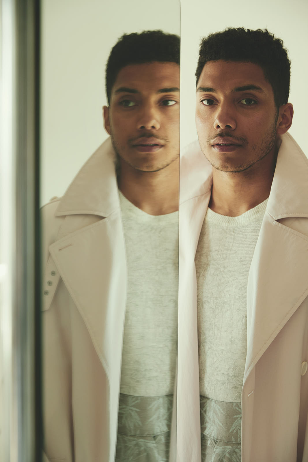 Chance wears trench coat Hugo Boss, sweater and pants Etro