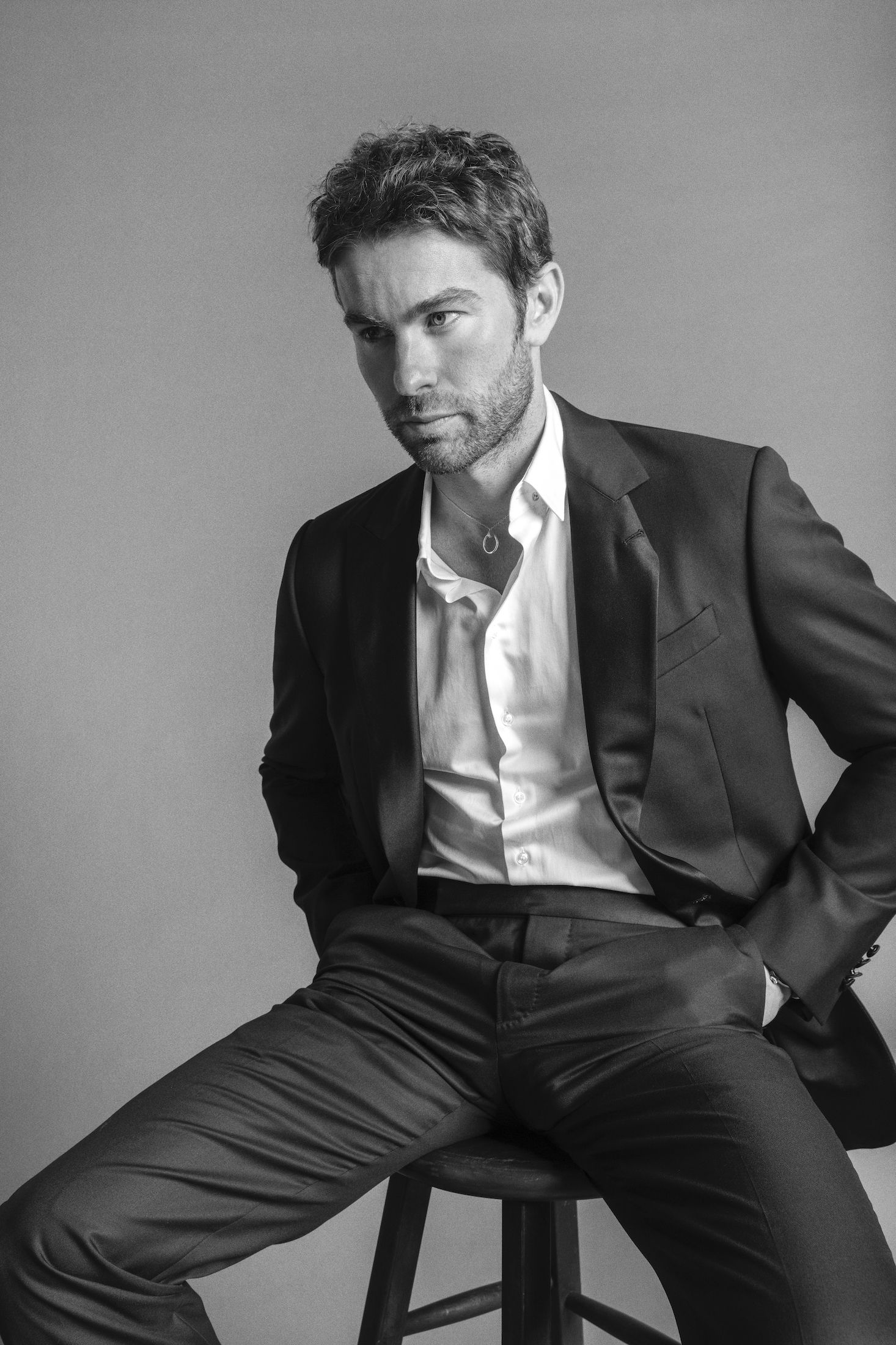 Chace wears a suit jacket, pants, and shirt Giorgio Armani, necklace Cartier and watch Pasha de Cartier.